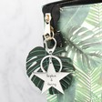 Silver Engraved Personalised Shiny Star Keyring on Bag
