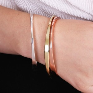 Set of Three Twisted Mixed Metal Bangles