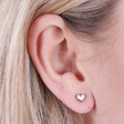 Resin and Crystal Heart Stud Earrings in Rose Gold on Model