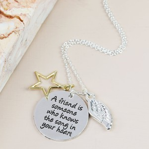'A friend is someone' silver necklace