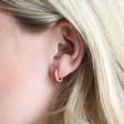 Coral Pink Enamel Huggie Hoop Earrings on Model