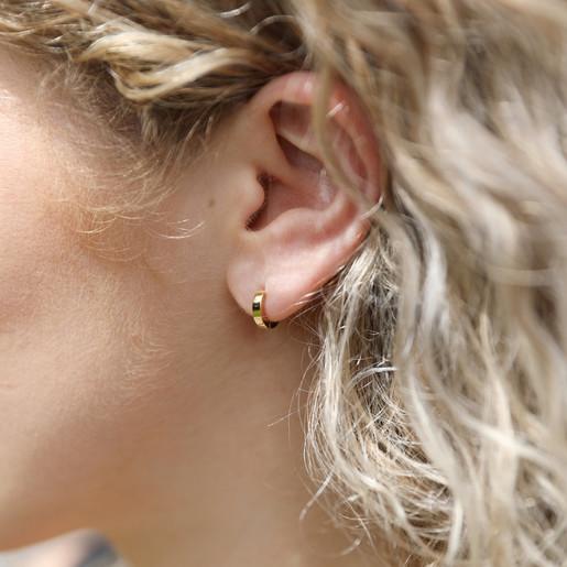 b3a751e5b Tiny Gold Sterling Silver Huggie Hoop Earrings on Model. Lisa Angel  Hypoallergenic Tiny Sterling ...