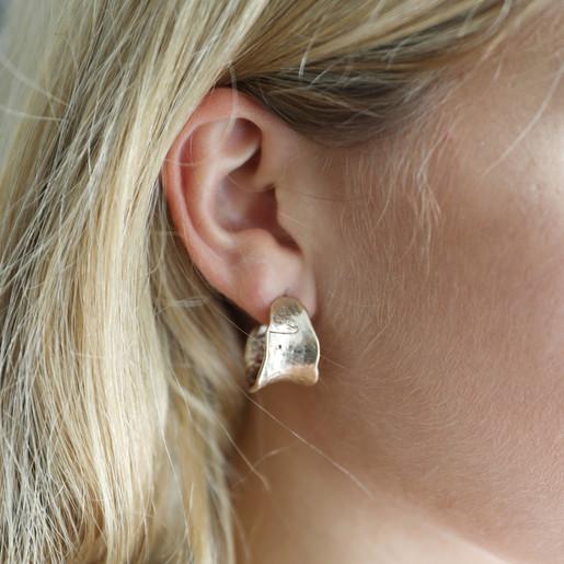 82b900f05 Wide Organic Effect Hoop Earrings in Gold on Model. Lisa Angel ...