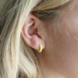 Yellow Enamel Huggie Hoop Earrings on Model