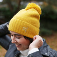 Mustard Yellow Personalised Soft Knit Bobble Hat on Model
