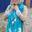 Women's Winter Deer Print Scarf in Teal on Model