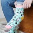 Model wears House of Disaster Moomin 'Family' Print Socks