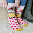Model wears Unisex House of Disaster Moomin 'Little My' Print Socks