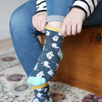 Model wears House of Disaster Moomin Print Socks