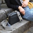 Lisa Angel Ladies' Personalised Embriodered Black Leather Crossbody Bag with Black and White Striped Strap on Model