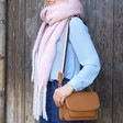 Lisa Angel Ladies' Tan Leather Saddle Bag with Blue and Pink Strap on Model