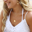 Ladies' Estella Bartlett Lucky Sixpence Necklace in Gold on Model