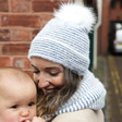 Blue and White Striped Bobble Hat on Model