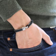 Men's Woven Black Cord and Stainless Steel Bead Bracelet on Model