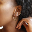 Gold Sterling Silver Aztec Hoop Earrings on Model