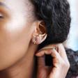 Tiny Gold Sterling Silver Slim Huggie Hoop Earrings on Model