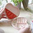 Inside of Metallic Arrows Heart Travel Jewellery Case in Pale Pink