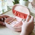 Inside of Ladies' Metallic Arrows Oval Travel Jewellery Box in Pale Pink