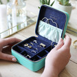 Inside of Lisa Angel Square Travel Jewellery Box in Mint Green and Navy