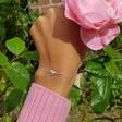 Ladies' Shiny Silver Heart Bracelet on Model