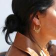 Ladies' Dangly Star Charm Hoop Earrings on Model