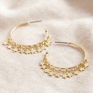 Dangly Star Charm Hoop Earrings in Gold