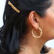 Large Twisted Gold Pearl Hoop Earrings on Model