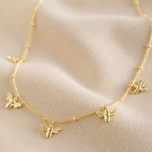 Tiny Bee Charms Necklace in Gold