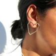 Organic Finish Large Heart Earrings in Silver on Model