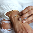 Women's Rainbow Crystal Initial Bracelet in Gold on Model