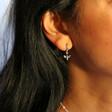 Tiny Bee Huggie Hoop Earrings in Silver on Model