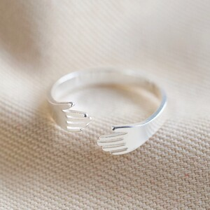 Adjustable Silver Hug Hands Ring