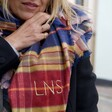 Personalised Embroidered Blue and Red Tartan Scarf on Model