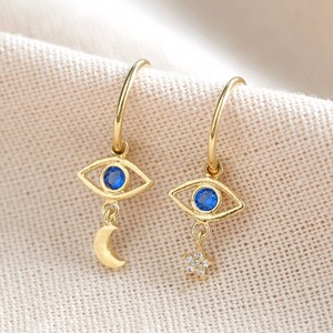 Crystal Eye Star and Moon Charm Hoop Earrings in Gold