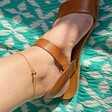 Ladies' Gold Bumblebee and Daisy Anklet on Model