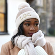 Embroidered Initials Soft Knit Pom Pom Beanie Hat in Natural on Model