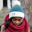 Embroidered Initials Soft Knit Pom Pom Beanie Hat in Teal on Model