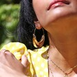 Statement Hammered Feature Hoop Earrings in Gold on Model