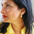 Model Wears Starfish and Freshwater Pearl Stud Earrings in Gold