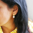 Starfish and Freshwater Pearl Stud Earrings in Gold on Model