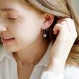 Model Wears Thread Through Moon and Sun Chain Earrings in Silver