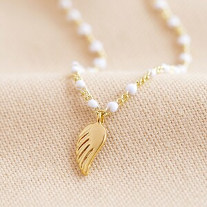 Enamel White Pearl Necklace With Wing Charm in Gold