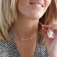 Female model wearing Lisa Angel Believe Charm Necklace in Silver