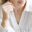 Model Wears Lisa angel Crystal Star Necklace in Silver
