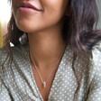 Model Wearing Lisa Angel Rainbow Crystal Edge Star Pendant Necklace in Silver