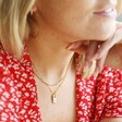 Female Model Wearing Personalised Tiny Hammered Tag Pendant Necklace with Birthstone Charm