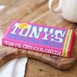 Front of Tony's Chocolonely White Chocolate Raspberry Popping Candy Bar