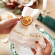 Model Holding Personalised Embroidered White Linen Napkin