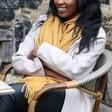 Model Wears Embroidered Birth Flower Lightweight Winter Scarf in Mustard