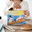 Model Holding Moomin Cotton Pouch with Ocean Design on Front